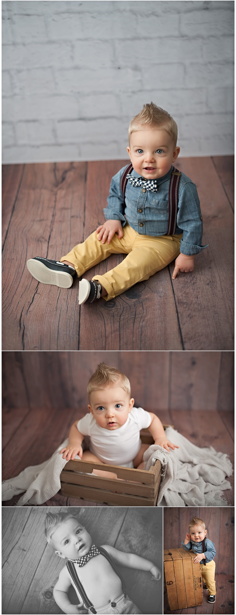 One year old baby boy in suspenders on wood floor with white brick backdrop