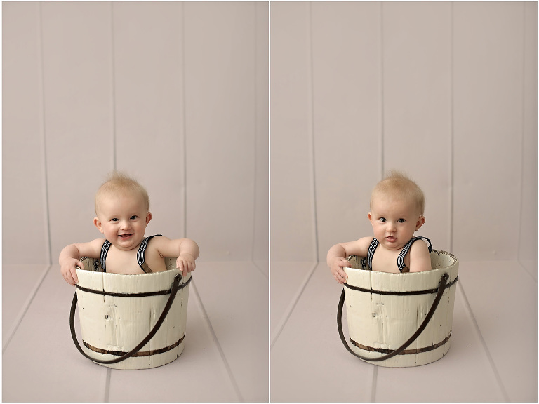 8 month old baby wearing suspenders sitting in whitewashed bucket