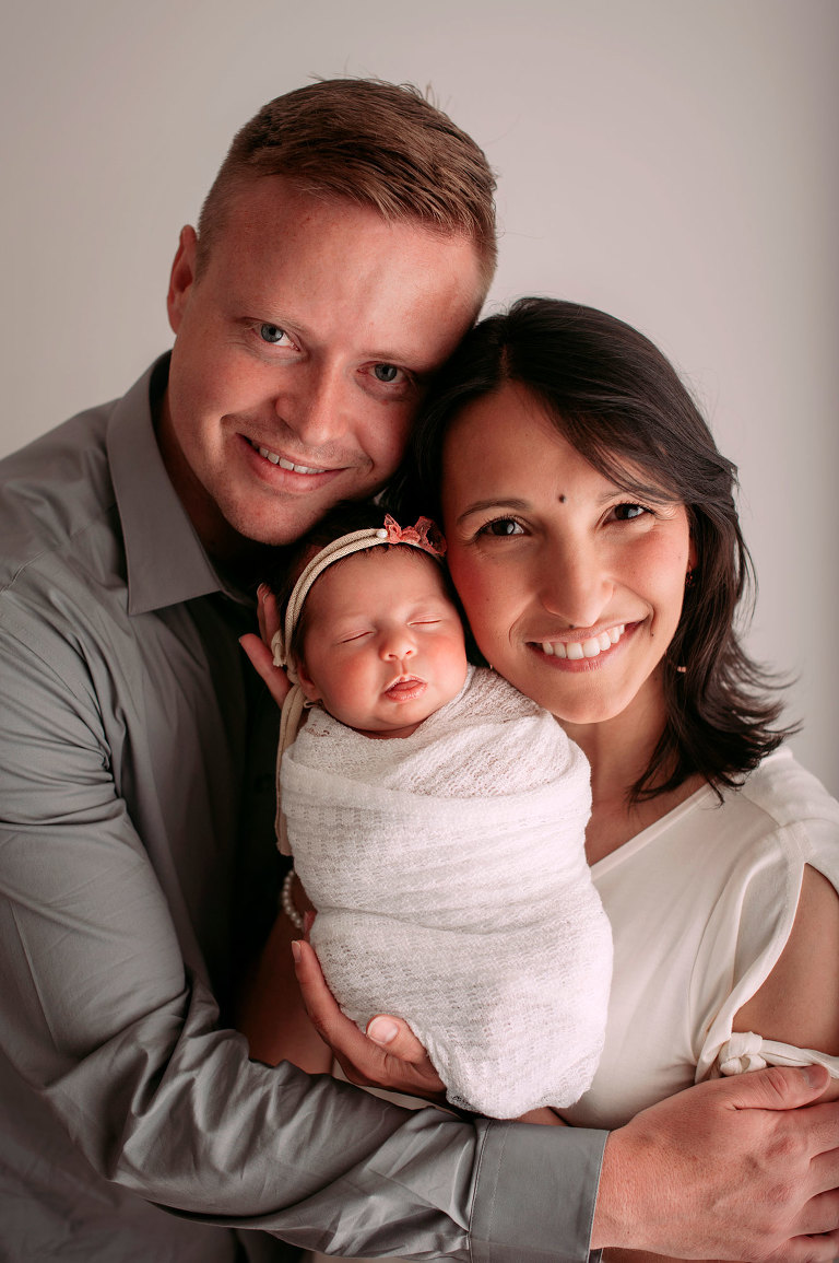 Newborn girl photography posing with mom and dad