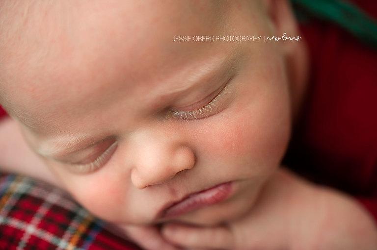 Macro shot of newborn baby boy's blonde eyelashes.